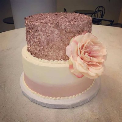 multilayer cake with large rose